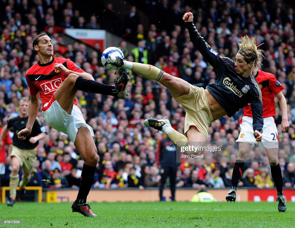 Fernando Torres of Liverpool clashes with Rio Ferdinand of Manchester United during the Barclays Premier League match between Manchester United and Liverpool at Old Trafford on March 21, 2010 in Manchester, England.
