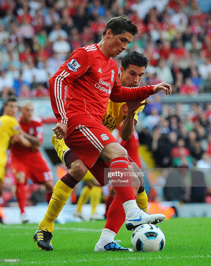 Fernando Torres of Liverpool competes with Robin Van Persie of Arsenal during the Barclays Premier League match between Liverpool and Arsenal at Anfield on August 15, 2010 in Liverpool, England.