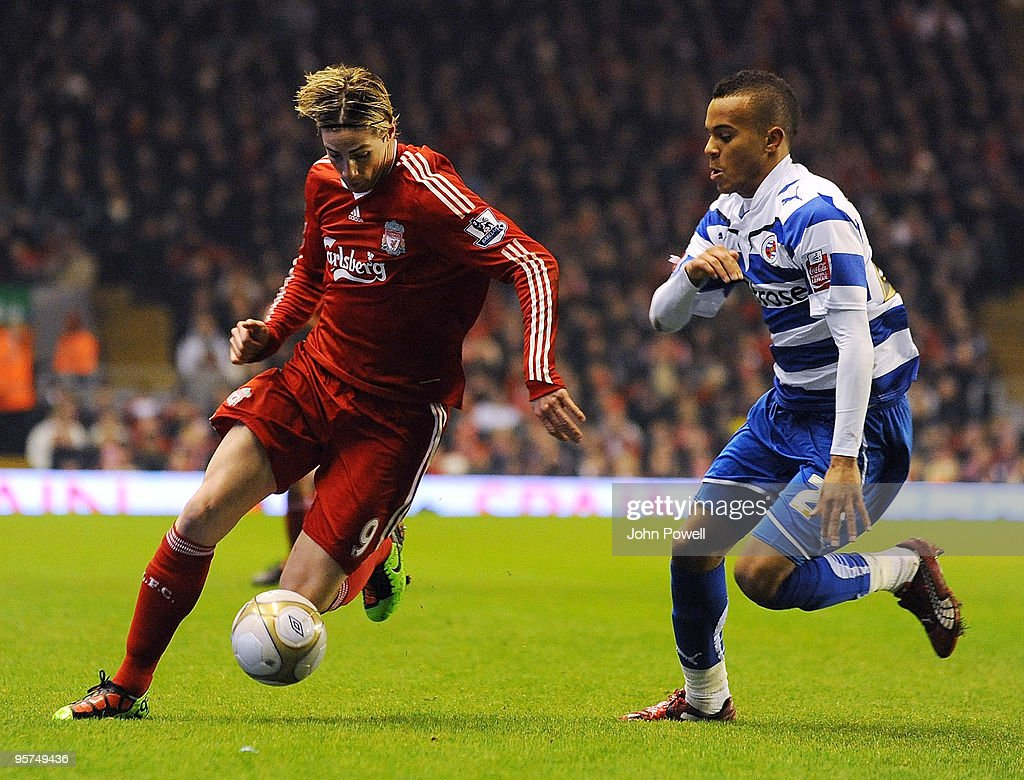 Fernando Torres of Liverpool competes with Ryan Bertrand of Reading during the FA Cup 3rd round replay match between Liverpool and Reading at Anfield...