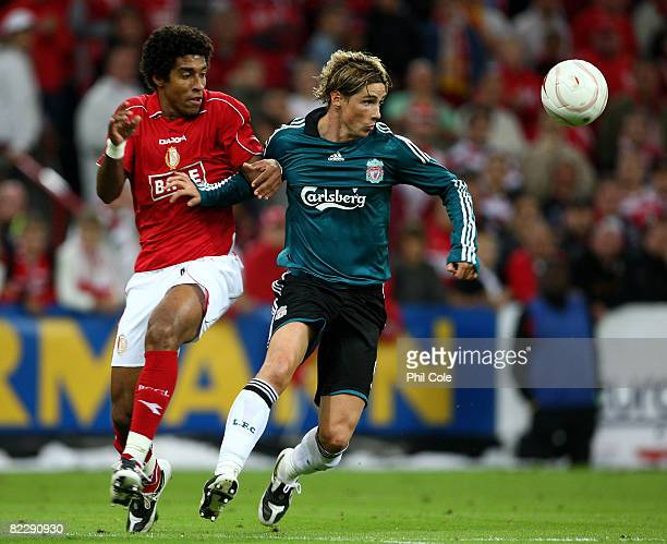 Fernando Torres of Liverpool gets tackled by Bonfirm da Costa Dante of Standard Liege during the UEFA Champions League 3rd Qualifying round 1st leg...