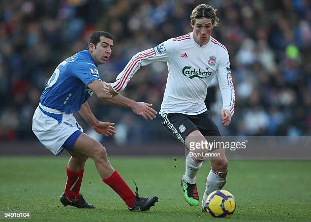Fernando Torres of Liverpool goes past Tal Ben Haim of Portsmouth during the Barclays Premier League match between Portsmouth and Liverpool at...
