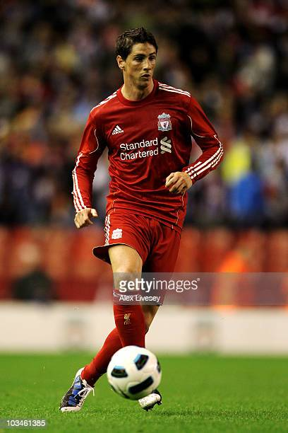 Fernando Torres of Liverpool in action during the UEFA Europa League playoff first leg match beteween Liverpool and Trabzonspor at Anfield on August...