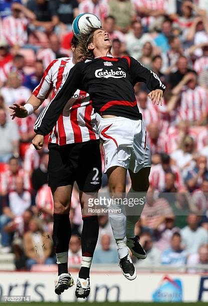 Fernando Torres of Liverpool is challenged by Greg Halford of Sunderland during the Barclays Premiership match between Sunderland and Liverpool at...