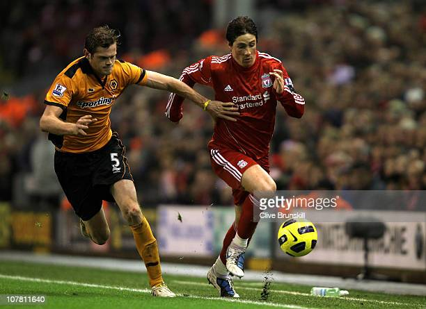 Fernando Torres of Liverpool is challenged by Richard Stearman of Wolverhampton Wanderers during the Barclays Premier League match between Liverpool...