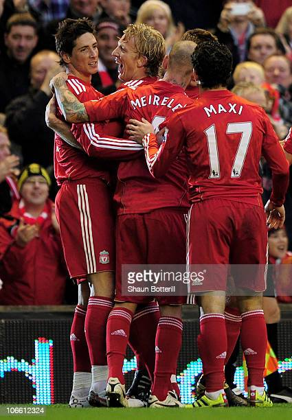 Fernando Torres of Liverpool is congratulated by his team mates after scoring the opening goal during the Barclays Premier League match between...