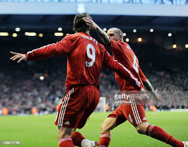 Fernando Torres of liverpool is congratulated by Raul Meireles of Liverpool after Torres' goal during the Barclays Premier League match between...