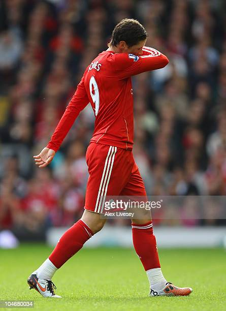 Fernando Torres of Liverpool looks dejected as he walks off the pitch following his substitution during the Barclays Premier League match between...