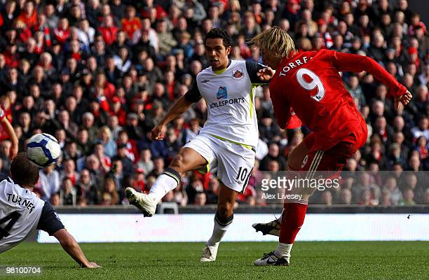 Fernando Torres of Liverpool scores his team's third goal during the Barclays Premier League match between Liverpool and Sunderland at Anfield on...