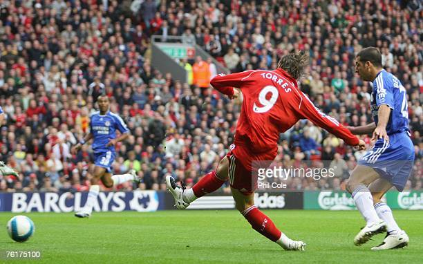 Fernando Torres of Liverpool scores the opening goal during the Barclays Premier League match between Liverpool and Chelsea at Anfield on August 19...