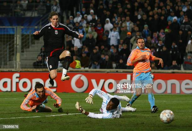 Fernando Torres of Liverpool scores the second goal past Steve Mandanda of Marseille during the UEFA Champions League Group A match between Marseille...