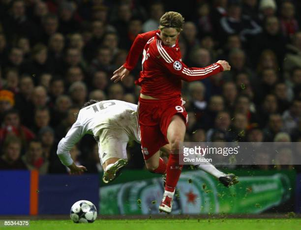 Fernando Torres of Liverpool tangles with Gabriel Heinze of Real Madrid during the UEFA Champions League Round of Sixteen Second Leg match between...