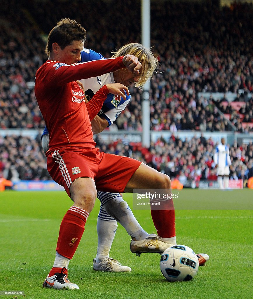 <a gi-track='captionPersonalityLinkClicked' href=/galleries/search?phrase=Fernando+Torres&family=editorial&specificpeople=194755 ng-click='$event.stopPropagation()'>Fernando Torres</a> of Liverpool tussles with <a gi-track='captionPersonalityLinkClicked' href=/galleries/search?phrase=Michel+Salgado&family=editorial&specificpeople=209291 ng-click='$event.stopPropagation()'>Michel Salgado</a> of Blackburn Rovers during the Barclays premier league match between Liverpool and Blackburn Rovers at Anfield on October 24, 2010 in Liverpool, England.