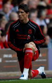 Fernando Torres of Liverpool warms up prior to coming on as a substitute during the Barclays Premier League match between Liverpool and Arsenal at...