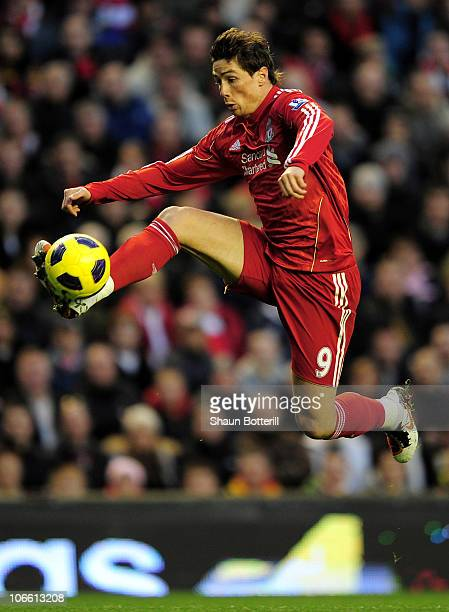 Fernando Torres of Liverpool wins the ball during the Barclays Premier League match between Liverpool and Chelsea at Anfield on November 7 2010 in...