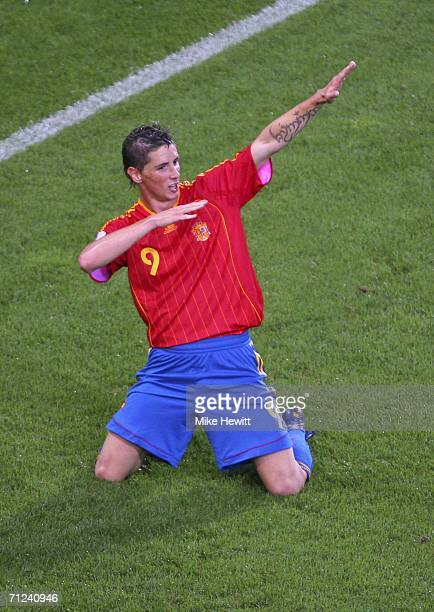 Fernando Torres of Spain celebrates after scoring his team's second goal during the FIFA World Cup Germany 2006 Group H match between Spain and...