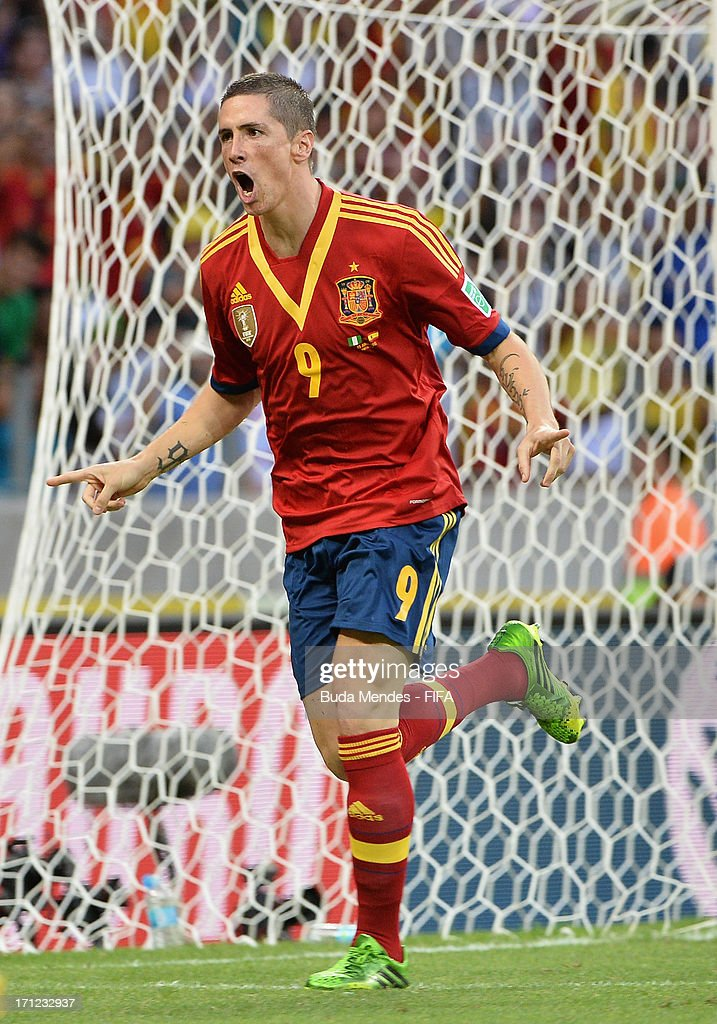 <a gi-track='captionPersonalityLinkClicked' href=/galleries/search?phrase=Fernando+Torres&family=editorial&specificpeople=194755 ng-click='$event.stopPropagation()'>Fernando Torres</a> of Spain celebrates as he scores their second goal during the FIFA Confederations Cup Brazil 2013 Group B match between Nigeria and Spain at Castelao on June 23, 2013 in Fortaleza, Brazil.