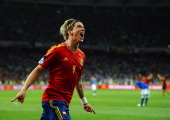 Fernando Torres of Spain celebrates scoring his side's third goal during the UEFA EURO 2012 final match between Spain and Italy at the Olympic...