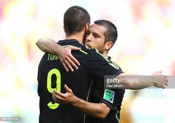 Fernando Torres of Spain celebrates scoring his team's second goal with Jordi Alba during the 2014 FIFA World Cup Brazil Group B match between...