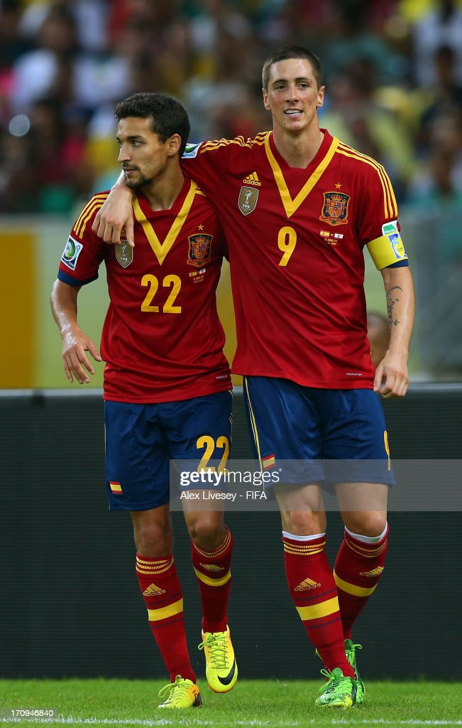 <a gi-track='captionPersonalityLinkClicked' href=/galleries/search?phrase=Fernando+Torres&family=editorial&specificpeople=194755 ng-click='$event.stopPropagation()'>Fernando Torres</a> of Spain celebrates scoring his team's sixth goal with team-mate Jesus Navas (L) during the FIFA Confederations Cup Brazil 2013 Group B match between Spain and Tahiti at the Maracana Stadium on June 20, 2013 in Rio de Janeiro, Brazil.