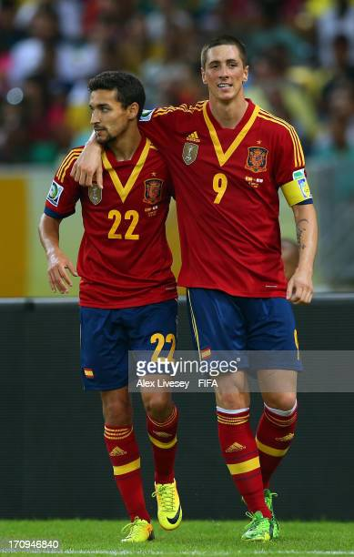 Fernando Torres of Spain celebrates scoring his team's sixth goal with teammate Jesus Navas during the FIFA Confederations Cup Brazil 2013 Group B...