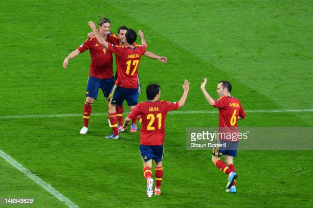 Fernando Torres of Spain celebrates scoring their third goal with team mates during the UEFA EURO 2012 group C match between Spain and Ireland at The...