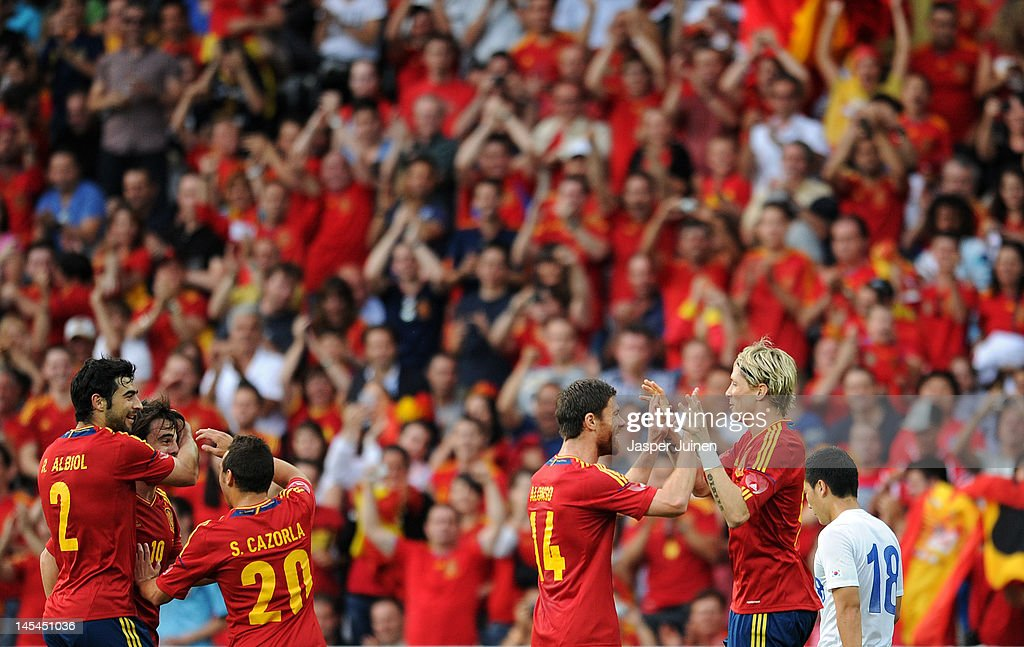 Fernando Torres (2nd R) of Spain celebrates scoring with his teammate Xabi Alonso (3rd R) and Santi Cazorla (3rd L), Benat Etxebarria (2nd L) and Raul Albiol (L) as Tae Hee Nam (R) of Korea Republic trudges past during the international friendly match between Spain and Korea Republic on May 30, 2012 in Bern, Switzerland.