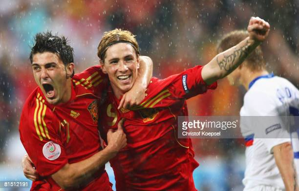 Fernando Torres of Spain celebrates with goalscorer David Villa of Spain during the UEFA EURO 2008 Group D match between Spain and Russia at Stadion...