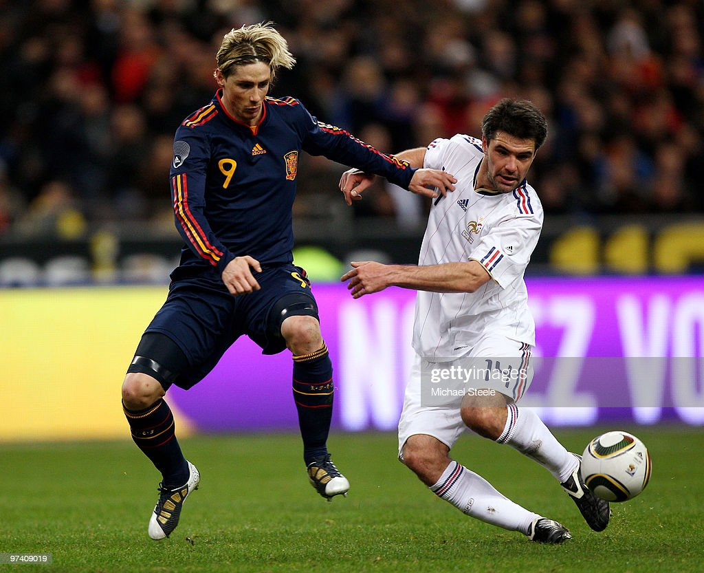 <a gi-track='captionPersonalityLinkClicked' href=/galleries/search?phrase=Fernando+Torres&family=editorial&specificpeople=194755 ng-click='$event.stopPropagation()'>Fernando Torres</a> (l) of Spain challenges <a gi-track='captionPersonalityLinkClicked' href=/galleries/search?phrase=Jeremy+Toulalan&family=editorial&specificpeople=4321622 ng-click='$event.stopPropagation()'>Jeremy Toulalan</a> (r) during the during the International friendly match betweem France and Spain at the Stade de France on March 3, 2010 in Paris, France.