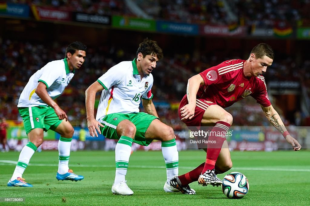 <a gi-track='captionPersonalityLinkClicked' href=/galleries/search?phrase=Fernando+Torres&family=editorial&specificpeople=194755 ng-click='$event.stopPropagation()'>Fernando Torres</a> of Spain competes for the ball with <a gi-track='captionPersonalityLinkClicked' href=/galleries/search?phrase=Ronald+Raldes&family=editorial&specificpeople=771201 ng-click='$event.stopPropagation()'>Ronald Raldes</a> of Bolivia an international friendly match between Spain and Bolivia at Estadio Ramon Sanchez Pizjuan on May 30, 2014 in Seville, Spain.