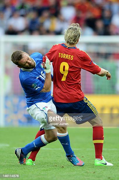 Fernando Torres of Spain fouls Daniele De Rossi of Italy during the UEFA EURO 2012 group C match between Spain and Italy at The Municipal Stadium on...