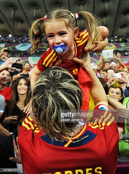 Fernando Torres of Spain holds his daughter Nora Torres following victory in the UEFA EURO 2012 final match between Spain and Italy at the Olympic...