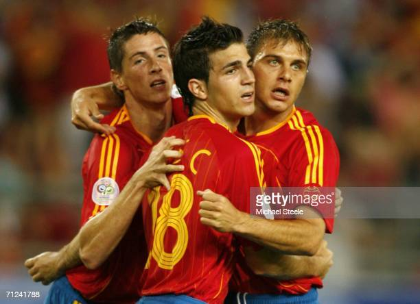 Fernando Torres of Spain is congratulated by teammates Cesc Fabregas and Joaquin after scoring his team's second goal during the FIFA World Cup...