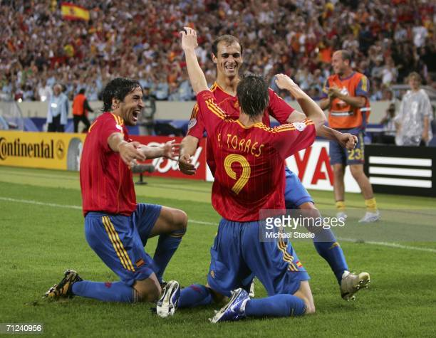 Fernando Torres of Spain is congratulated by teammates Mariano Pernia and Raul after scoring his team's second goal during the FIFA World Cup Germany...