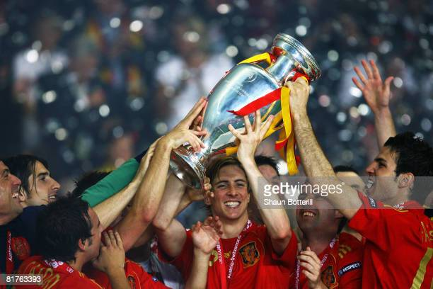 Fernando Torres of Spain lifts the trophy with teammates after winning against Germany in the UEFA EURO 2008 Final match between Germany and Spain at...