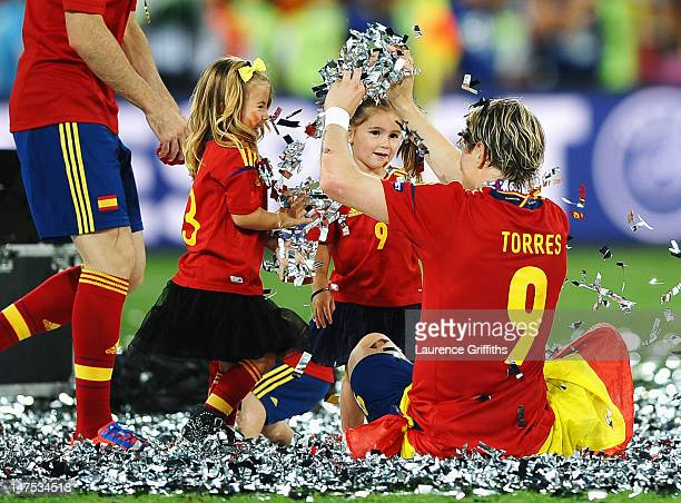 Fernando Torres of Spain plays in the confetti with his daughter Nora Torres and another player's daughter during the UEFA EURO 2012 final match...