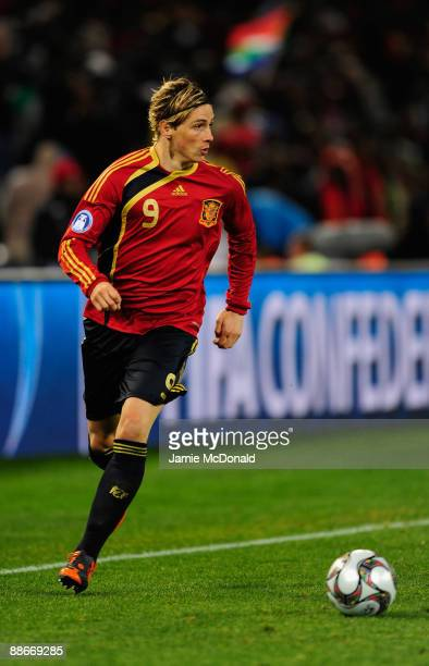 Fernando Torres of Spain runs with the ball during the FIFA Confederations Cup Semi Final match between Spain and USA at Free State Stadium on June...