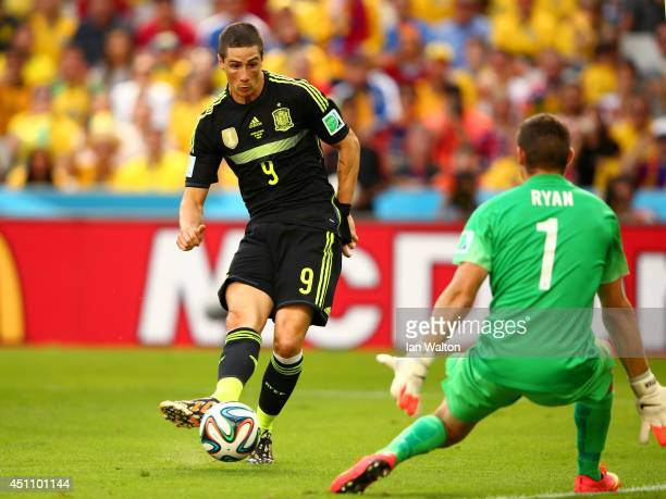 Fernando Torres of Spain scores his team's second goal past Mathew Ryan of Australia during the 2014 FIFA World Cup Brazil Group B match between...