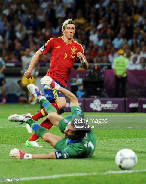 Fernando Torres of Spain scores his team's third goal past Gianluigi Buffon of Italy during the UEFA EURO 2012 final match between Spain and Italy at...