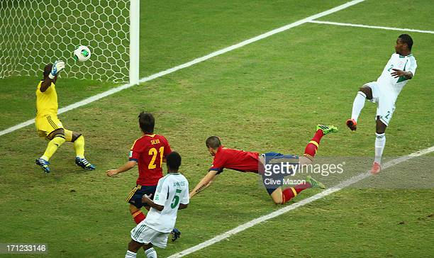 Fernando Torres of Spain scores their second goal with a header past Vincent Enyeama of Nigeria during the FIFA Confederations Cup Brazil 2013 Group...