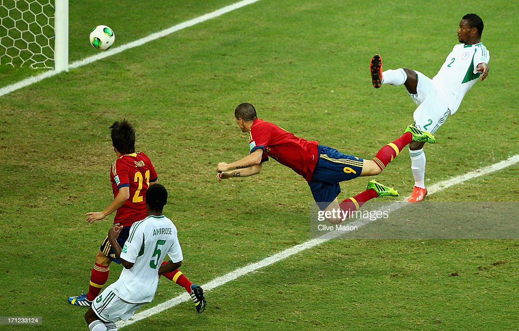 Fernando Torres of Spain scores their second goal with a header during the FIFA Confederations Cup Brazil 2013 Group B match between Nigeria and Spain at Castelao on June 23, 2013 in Fortaleza, Brazil.