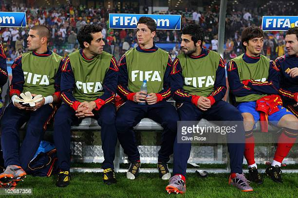 Fernando Torres of Spain sits on the substitutes bench with team mates ahead of the 2010 FIFA World Cup South Africa Semi Final match between Germany...