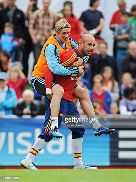 Fernando Torres of Spain takes a ride on goalkeeper's Pepe Reina his back during a training session on May 28 2012 in Schruns Austria