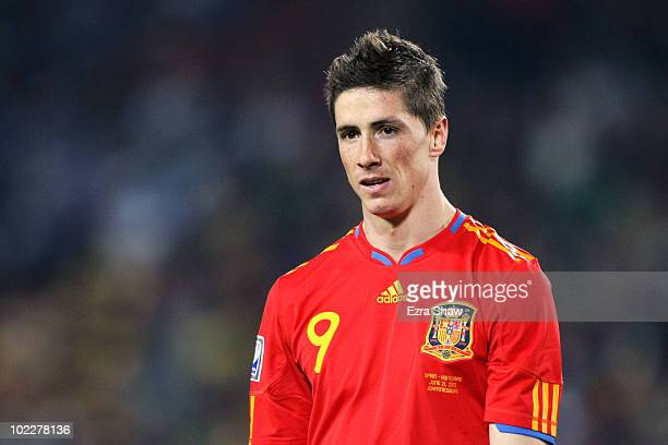 Fernando Torres of Spain walks off the pitch after being substituted during the 2010 FIFA World Cup South Africa Group H match between Spain and...
