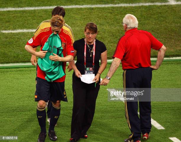 Fernando Torres of Spain walks past Luis Aragones coach of Spain after being substituted during the UEFA EURO 2008 Quarter Final match between Spain...