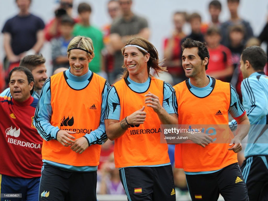 <a gi-track='captionPersonalityLinkClicked' href=/galleries/search?phrase=Fernando+Torres&family=editorial&specificpeople=194755 ng-click='$event.stopPropagation()'>Fernando Torres</a> (L), Sergio Ramos and <a gi-track='captionPersonalityLinkClicked' href=/galleries/search?phrase=Alvaro+Arbeloa&family=editorial&specificpeople=3941965 ng-click='$event.stopPropagation()'>Alvaro Arbeloa</a> of Spain smile as they excercise during a training session on May 28, 2012 in Schruns, Austria.