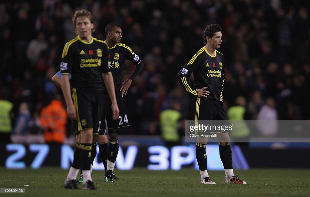 <a gi-track='captionPersonalityLinkClicked' href=/galleries/search?phrase=Fernando+Torres&family=editorial&specificpeople=194755 ng-click='$event.stopPropagation()'>Fernando Torres</a>,David Ngog and <a gi-track='captionPersonalityLinkClicked' href=/galleries/search?phrase=Lucas+Leiva+-+Defensive+Midfielder+-+Born+1987&family=editorial&specificpeople=4114250 ng-click='$event.stopPropagation()'>Lucas Leiva</a> of Liverpool show their dejection after Stoke have scored the second goal during the Barclays Premier League match between Stoke City and Liverpool at Britannia Stadium on November 13, 2010 in Stoke on Trent, England.