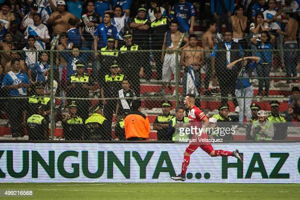 Fernando Uribe celebrates after scoring the opening goal during the quarterfinals second leg match between Toluca and Puebla as part of the Apertura...