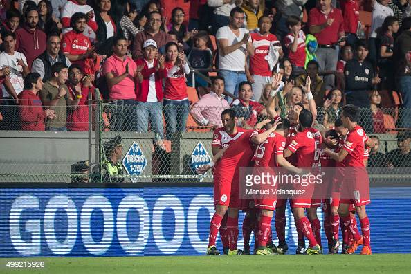 Fernando Uribe celebrates with his teammates after scoring the opening goal during the quarterfinals second leg match between Toluca and Puebla as...