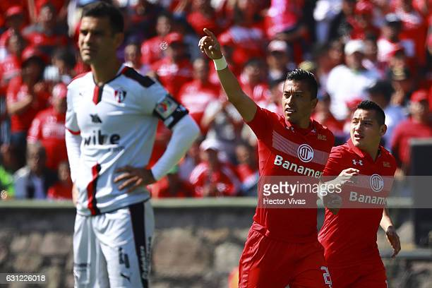 Fernando Uribe of Toluca celebrates after scoring the first goal of his team during the 1st round match between Toluca and Atlas as part of the...