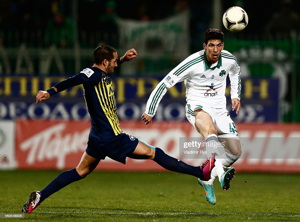 Fernando Usero of Tripolis defends as Konstantinos Triantafyllopoulos of Panathinaikos kicks the ball during the Superleague match between Asteras Tripolis and Panathinaikos FC at Asteras Tripolis Stadium on February 2, 2013 in Tripolis, Greece.
